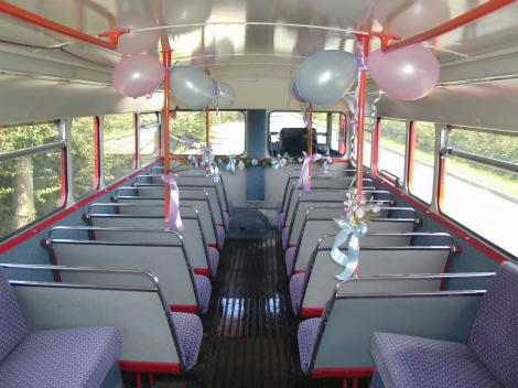 Routemaster upper saloon interior, with blue and pink decorations