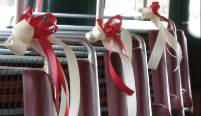 Red and white ribbons on seats