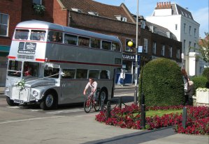 [Silver Routemaster, Cyclist, Pedestrian and Flowerbed in St Albans]
